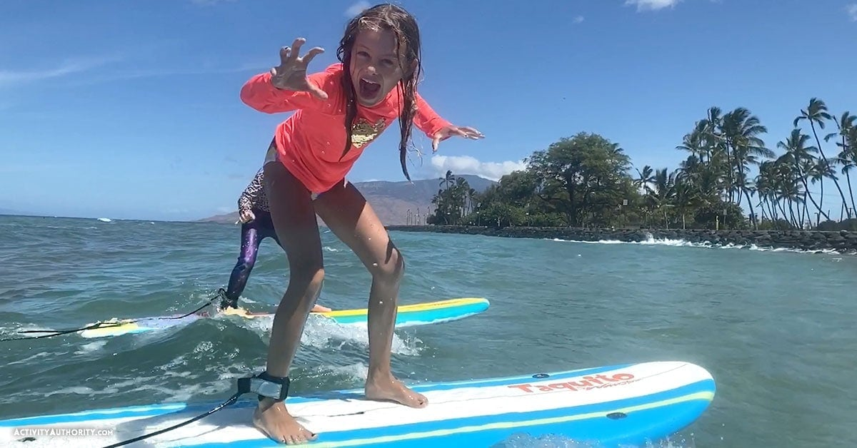 kids surfing in Maui
